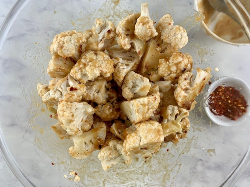 MIXING CAULIFLOWER FLORETS & MISO MARINADE TO COMBINE