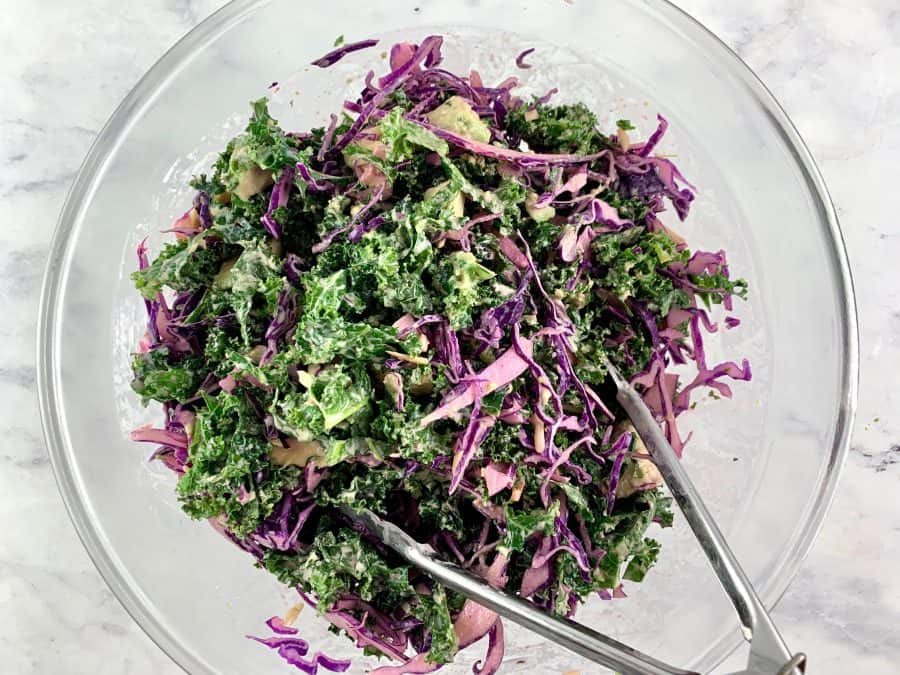 MIXING KALE AVOCADO SALAD TO COMBINE