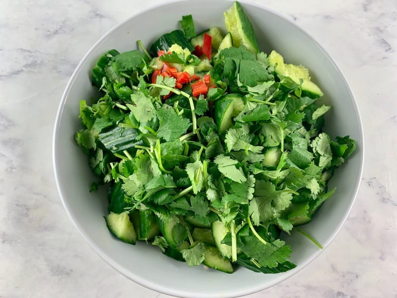 SMASHED CUCUMBER INGREDIENTS IN A SALAD BOWL
