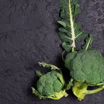 Broccoli and leaves on dark background