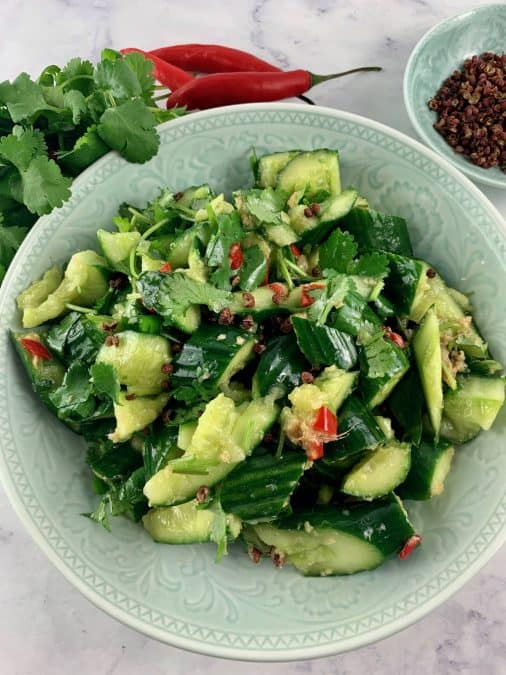 PAI HUNAG GUA salad with chlli, cilantro and szechuan in background