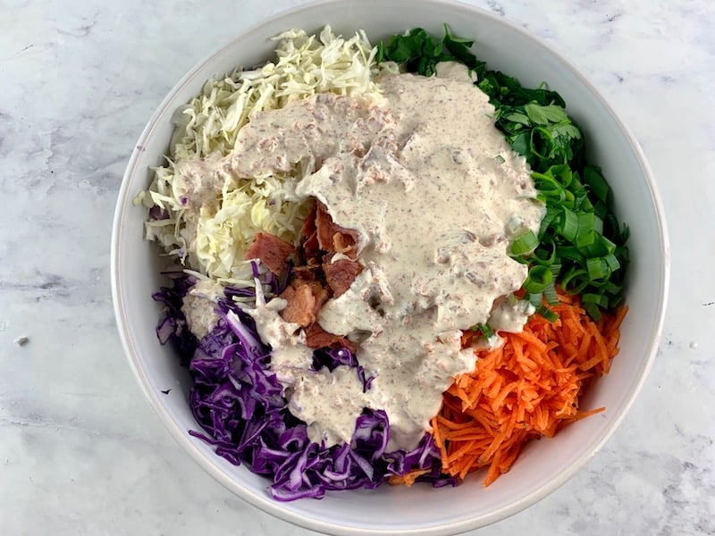 POURING BACON DRESSING OVER KETO COLESLAW INGREDIENTS