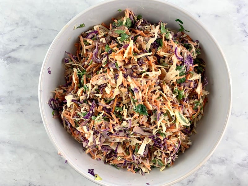 MIXING COLESLAW IN A MIXING BOWL TO COMBINE