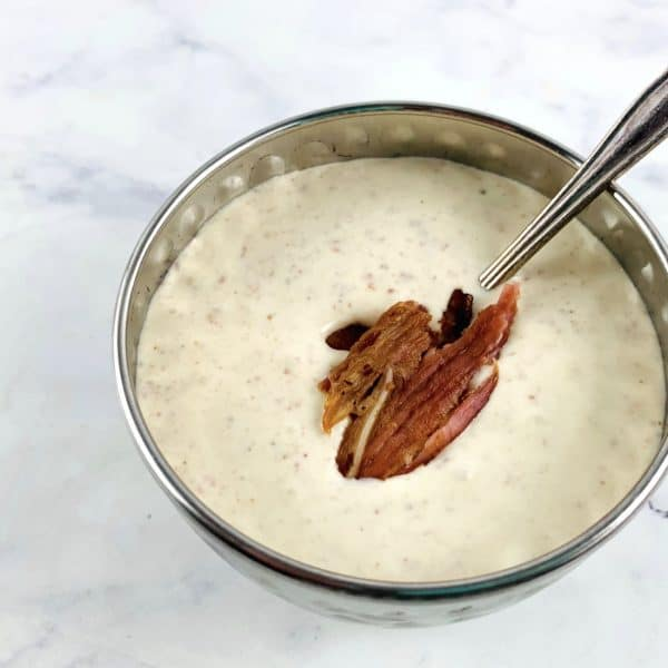 CREAMY BACON DRESSING IN A SILVER BOWL WITH SPOON