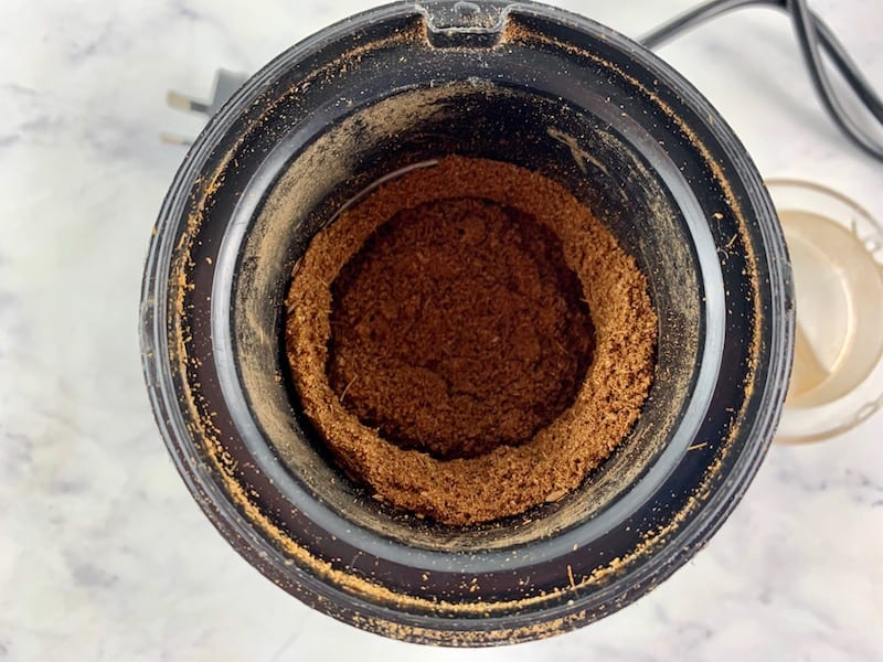 CUMIN SEEDS GROUND TO A POWDER IN SPICE BLENDER