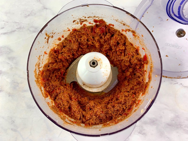 BLITZED HARISSA PASTE IN THE BOWL OF A FOOD PROCESSOR