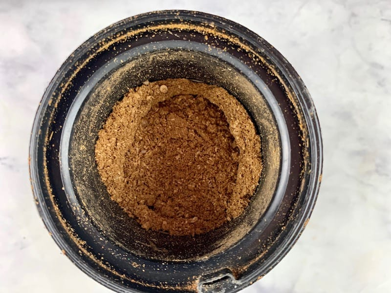 CORIANDER SEEDS GROUND TO A POWDER IN SPICE BLENDER