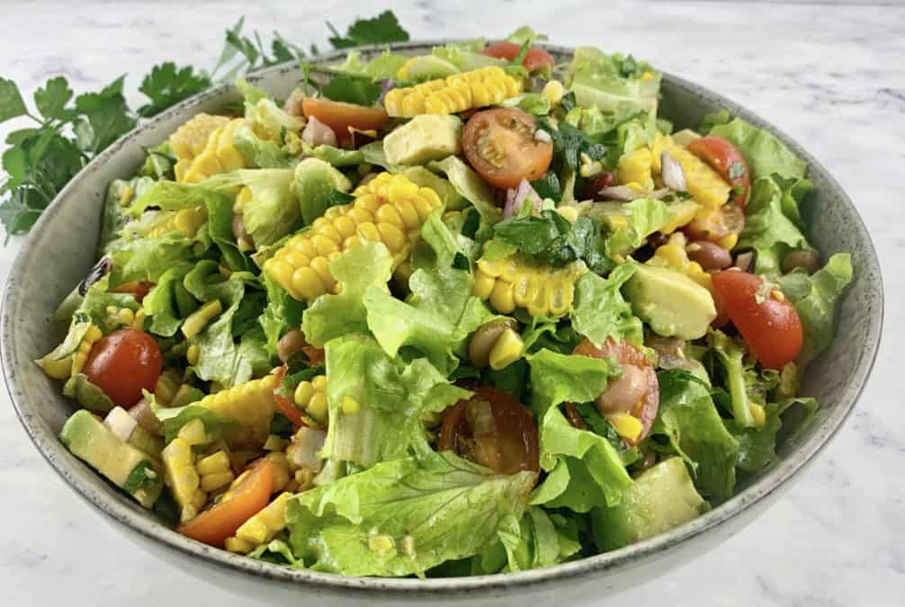 FIESTA SALAD IN A SALAD BOWL WITH PARSLEY ON THE SIDE