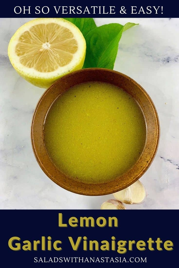LEMON GARLIC VINAIGRETTE IN A STONE BOWL WITH LEMON AND GARLIC ON THE SIDE AND A TEXT OVERLAY