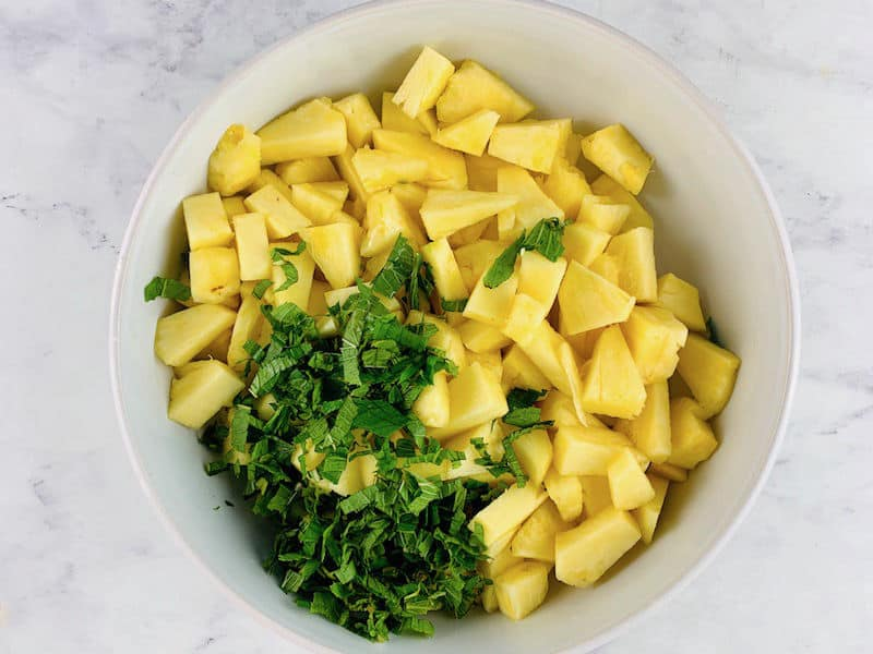FRESH PINEAPPLE AND MINT INGREDIENTS IN A WHITE BOWL