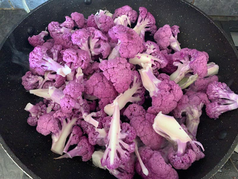 ADDING PURPLE CAULIFLOWER TO A HOT PAN