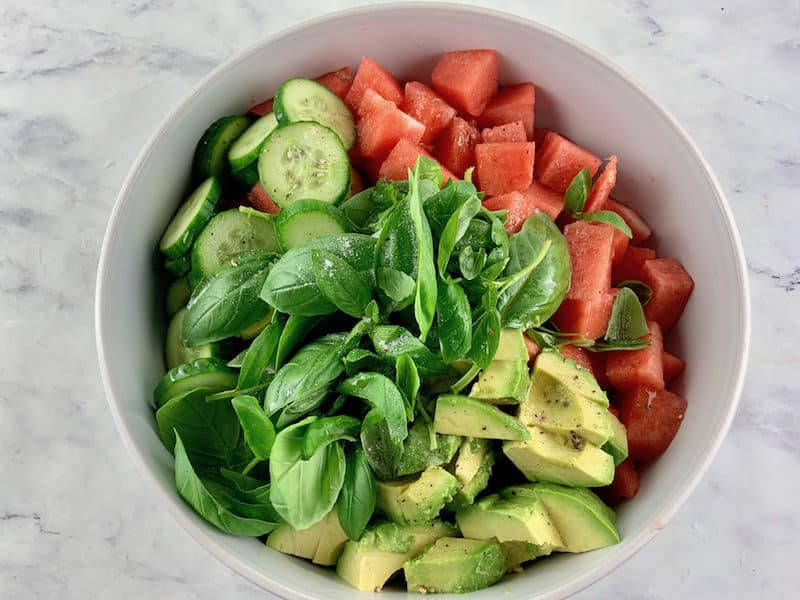 WATERMELON AVOCADO SALAD INGREDIENTS IN A WHITE BOWL