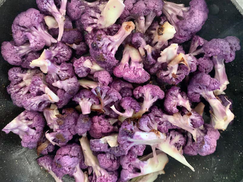 COOKED PURPLE CAULIFLOWER FLORETS IN PAN