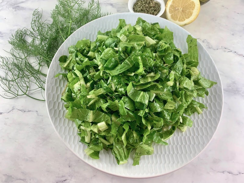 MAROULOSALATA ON WITHE PLATTER WITH FRESH DILL, OREGANO & CUT LEMON ON THE SIDE