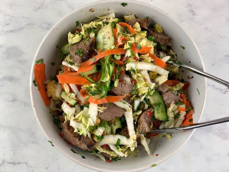 MIXING VIETNAMESE BEEF SALAD TO COMBINE