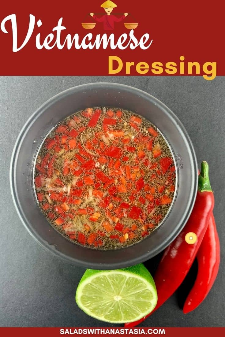 VIETNAMESE SALAD DRESSING IN BLACK BOWL WITH RED CHILLIES AND CUT LIME ON THE SIDE & TEXT OVERLAY