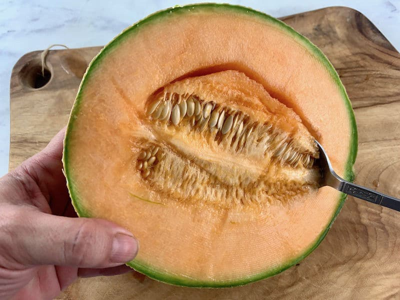 WASH MELON & USE SPOON TO SCOOP OUT SEEDS