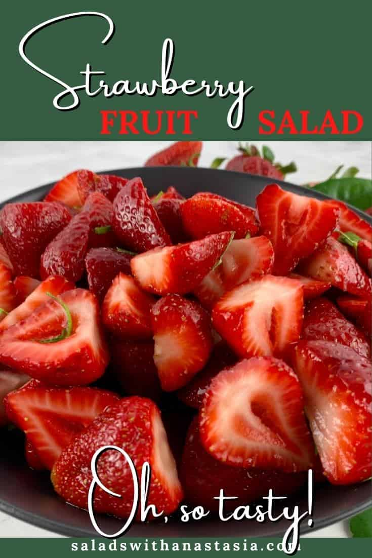 STRAWBERRIES AND LIME FRUIT SALAD IN A BLACK BOWL WITH STRAWBERRIES AND LIME LEAVES SCATTERED AROUND & TEXT OVERLAY