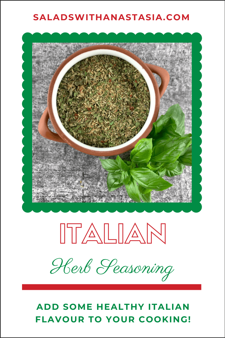 ITALIAN HERB SEASONING IN TERRACOTTA BOWL WITH BASIL SPRIG ON THE SIDE