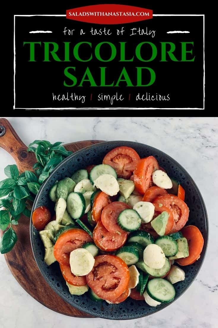 TRICOLORE SALAD IN A DARK GREY BOWL SITTING ON WOODEN BOARD WITH BASIL SPRIGS ON THE SIDE & TEXT OVERLAY