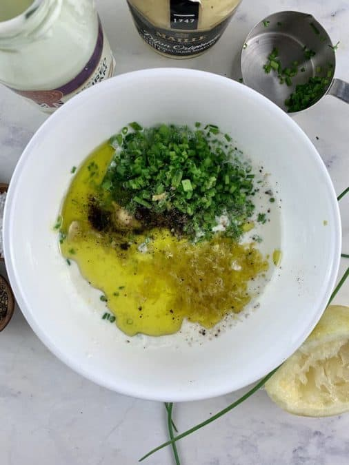 SOUR CREAM & CHIVE DRESSING INGREDIENTS IN BOWL & SCATTERED AROUND