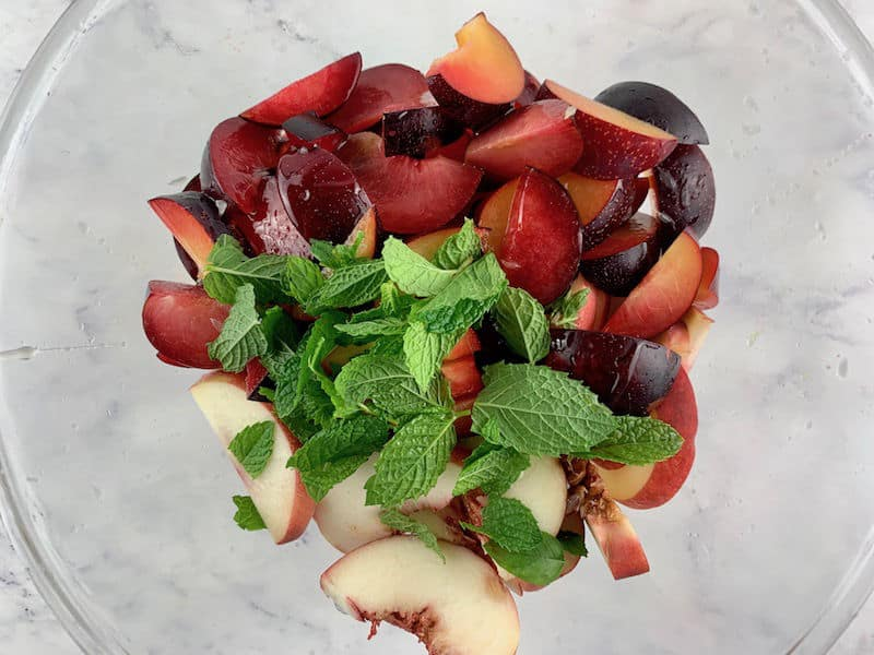 WHITE PEACH SALAD INGREDIENTS IN A GLASS BOWL