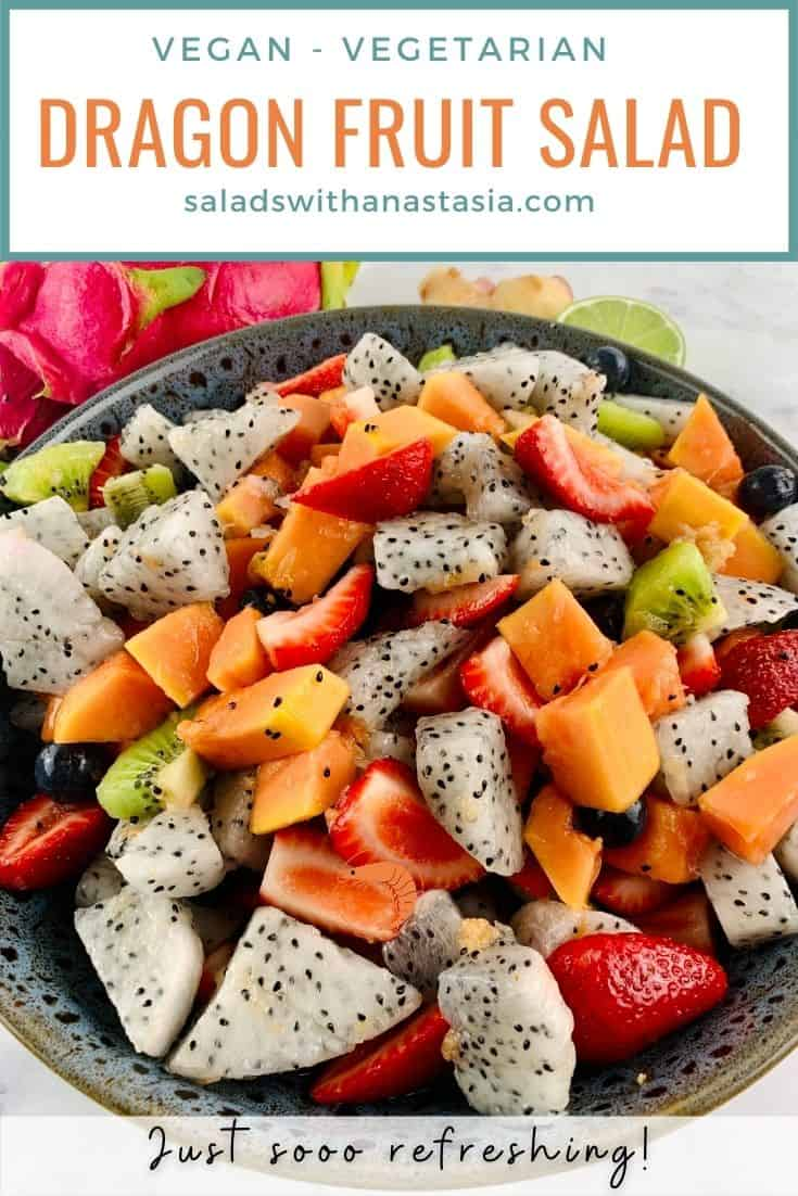 DRAGON FRUIT SALAD IN DARK GREY BOWL WITH DRAGON FRUIT, LIME & GINGER ON THE SIDE WITH TEXT OVERLAY