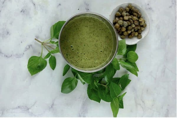 BASIL CAPER DRESSING IN SILVER BOWL WITH BASIL & CAPERS ON THE SIDE