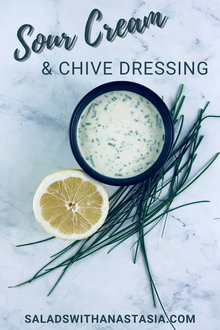 SOUR CREAM & CHIVE DRESSING IN A BLACK BOWL WITH CHIVES AND LEMON ON THE SIDE WITH A TEXT OVERLAY