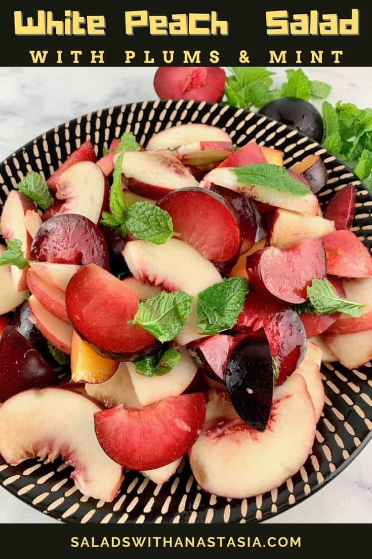 WHITE PEACH SALAD ON A BLACK PATTERNED PLATE WITH PLUMS AND MINT ON THE SIDE & TEXT OVERLAY