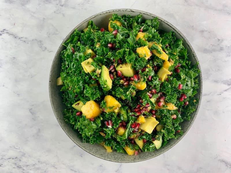 Kale mango salad in bowl