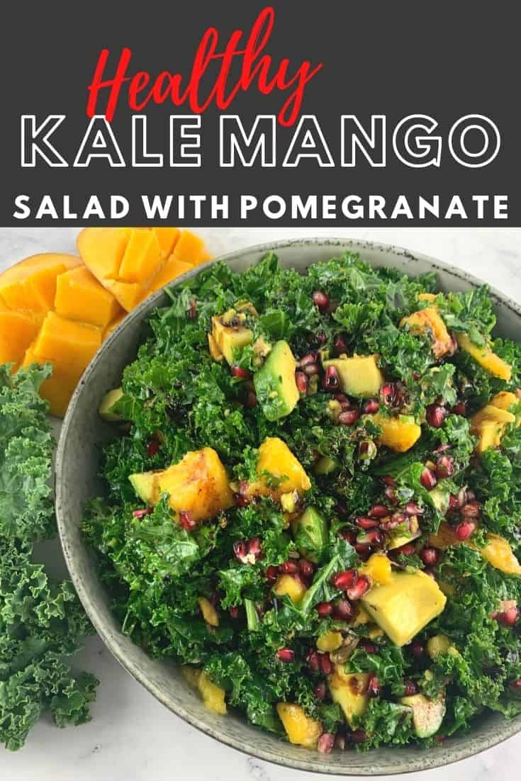 Kale mango salad in bowl with kale leaves and mango cheeks on the side & a text overlay